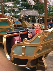 Garrett and Lydia riding kiddie rides with Brett at Silver Dollar City.